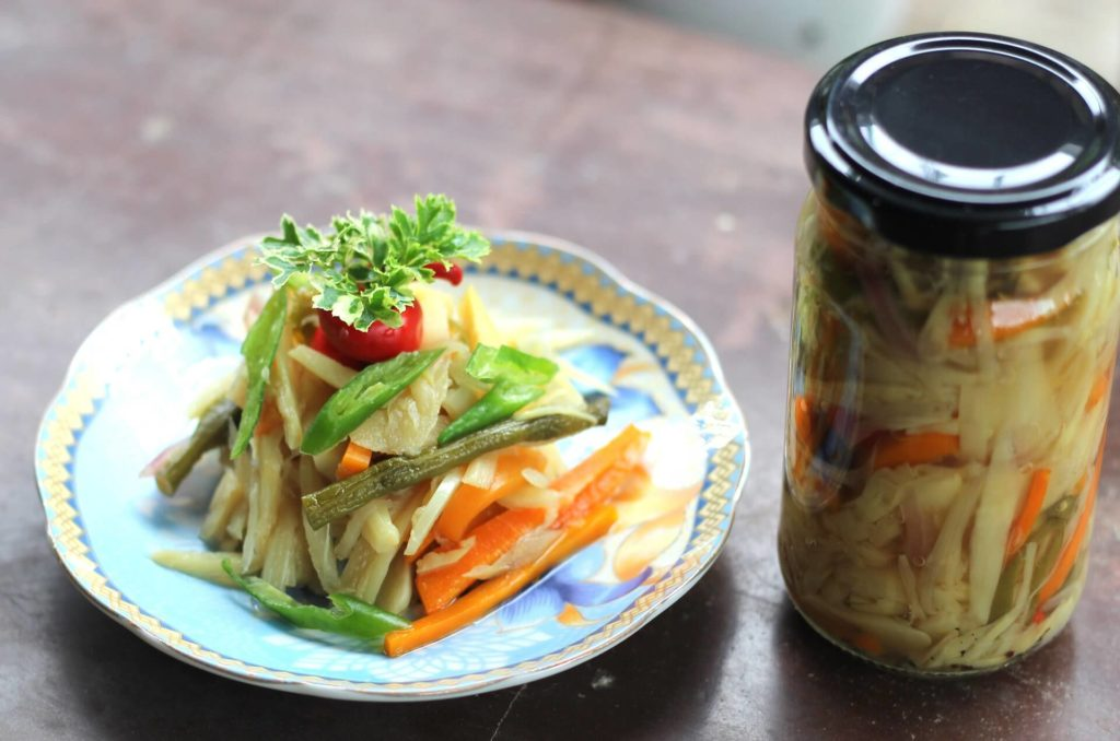 preserved bamboo shoots on a plate and in a jar